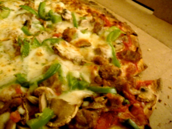 Thin crust with mushrooms, green peppers, and sausage. YUM!